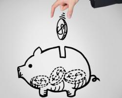 Piggy bank and a hand